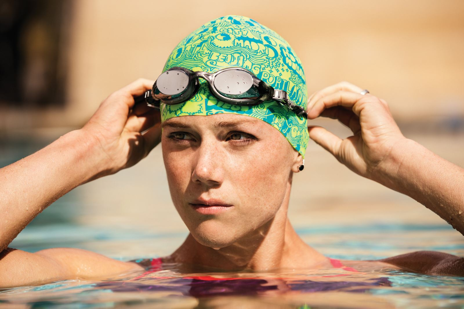 35ba732122a How to Put on a Swim Cap Without Pulling Your Hair