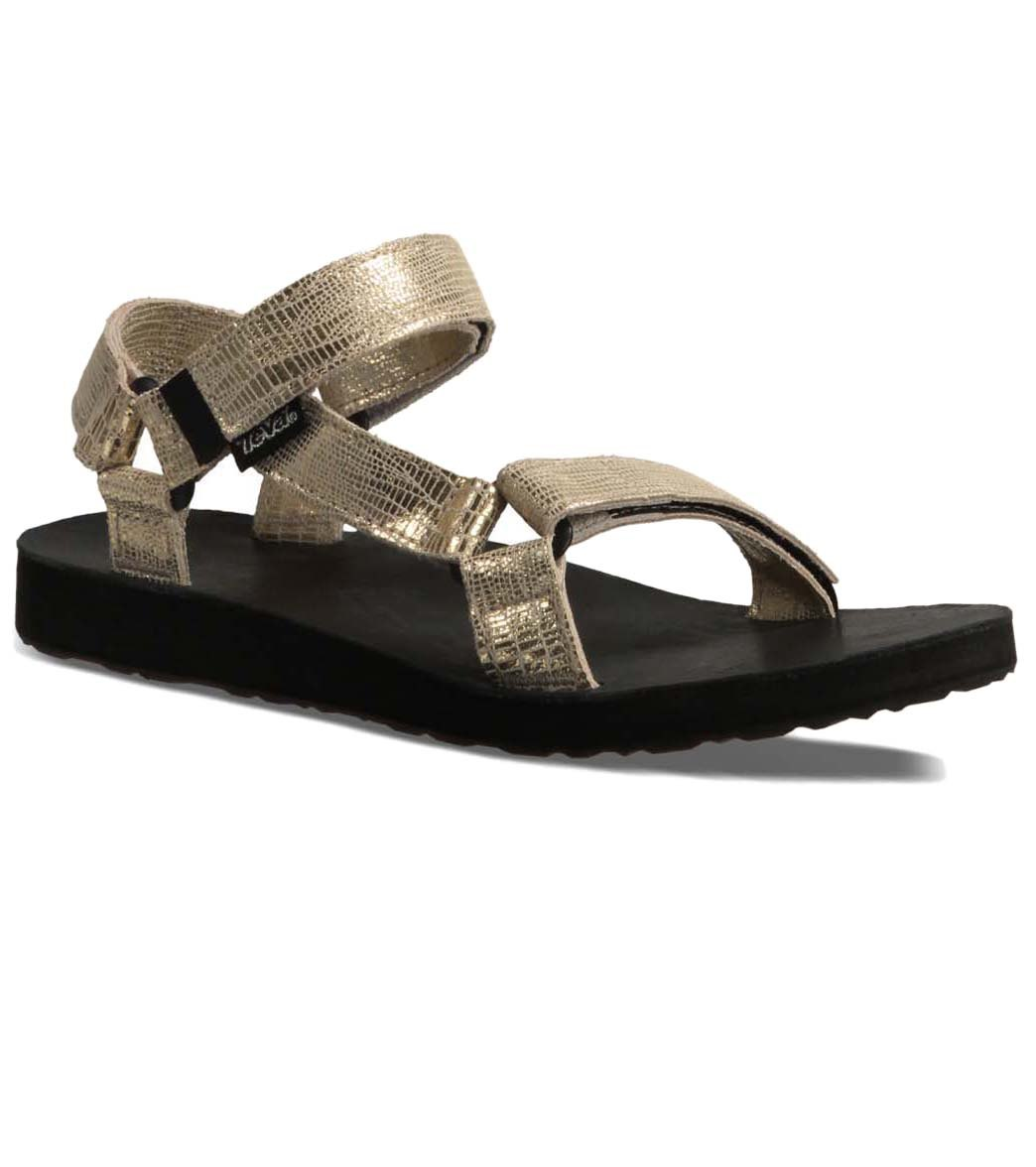 8547d7bca777 ... Teva Women s Original Universal Leather Metallic Sandal. Share