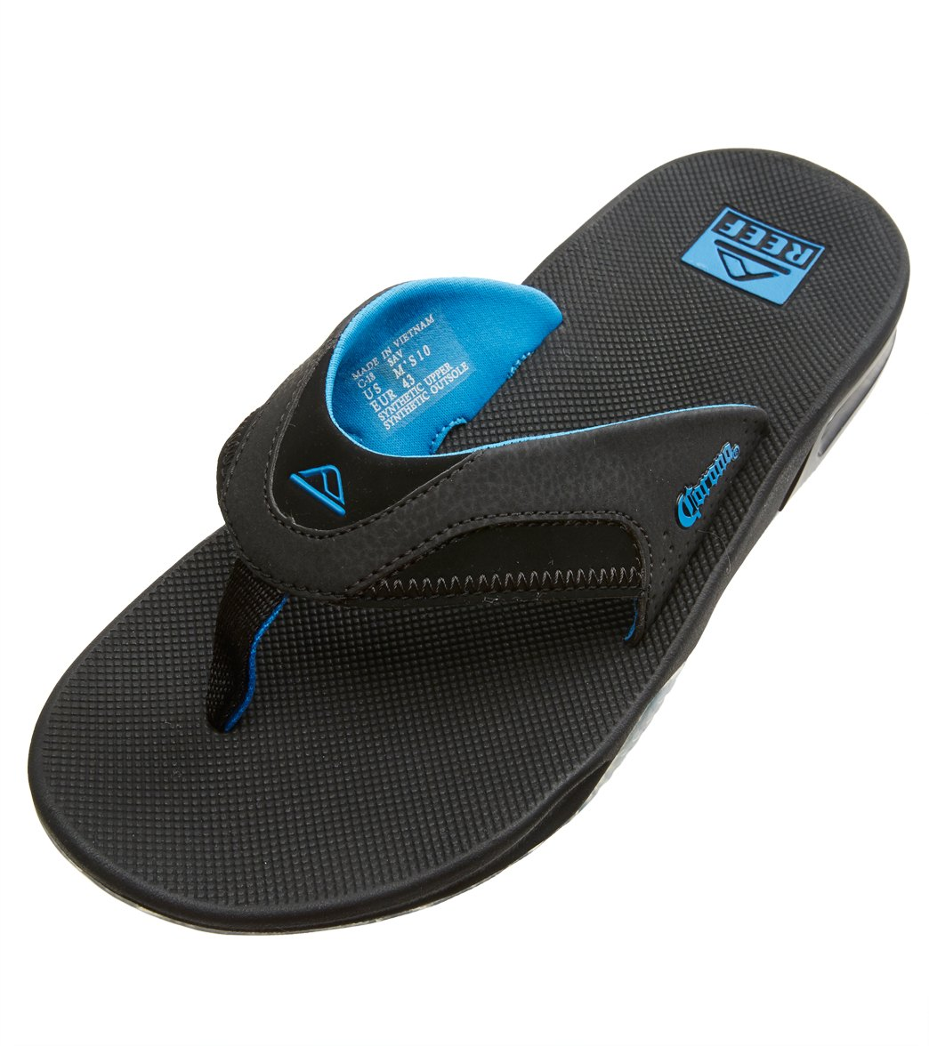 6459d710589d Reef Men s Fanning X Corona Flip Flop at SwimOutlet.com - Free Shipping